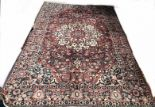 Lot 1060 - A large hand-made Kerman Carpet,