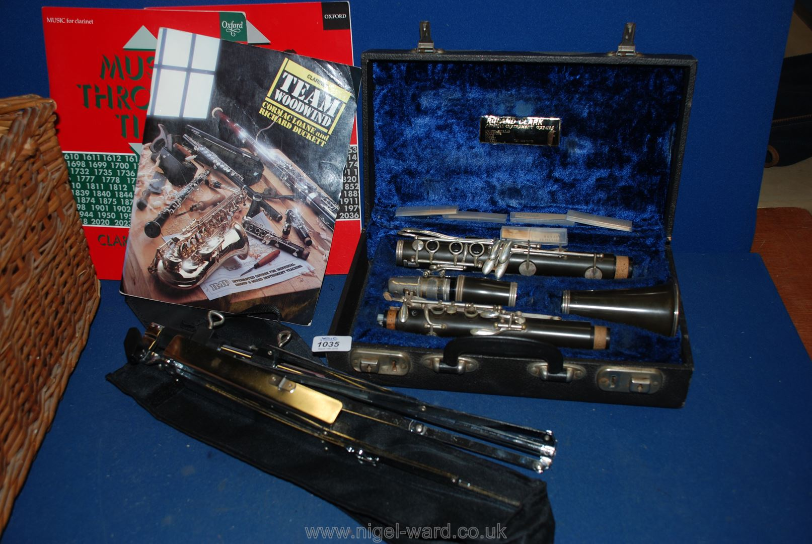 Lot 1035 - A Sapphire Clarinet in a fitted case, with instruction books and folding music stand.