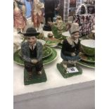 """A pair of hand painted """"Flemish"""" crouching figures"""