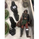 Two carved inuit figures plus two others