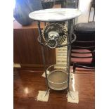 A metal and glass umbrella stand