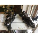 A pair of bronze wall cherubs