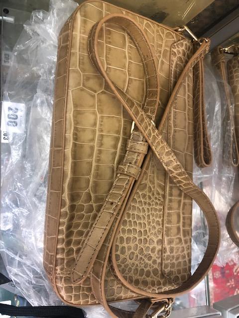 Lot 140 - A DKNY, camel- snake bag, brand new unused,
