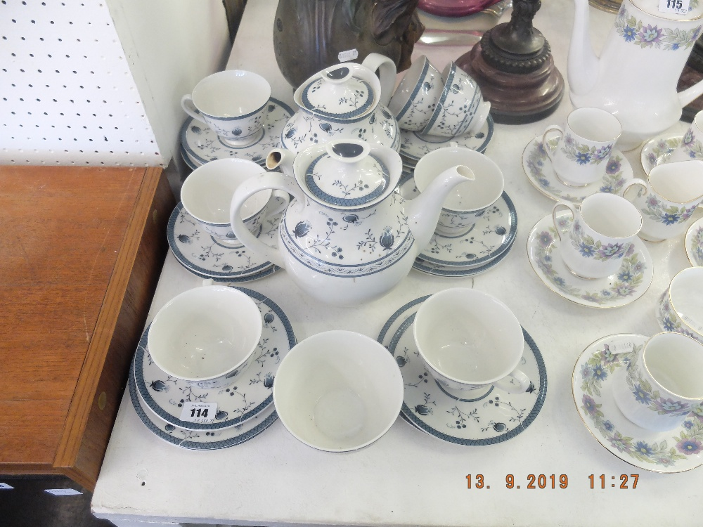 Lot 114 - A Royal Doulton Cambridge blue and white tea and coffee service