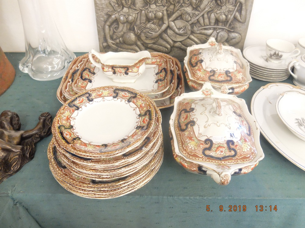 Lot 2 - A Lincoln pottery dinner set