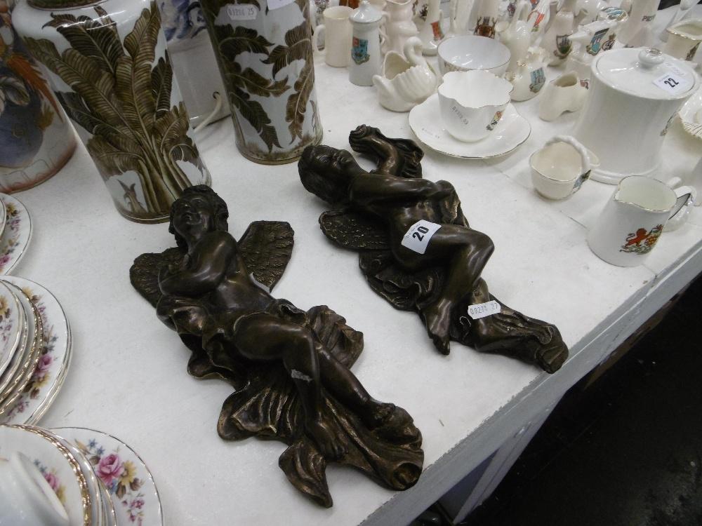 Lot 113 - A pair of bronze wall cherubs