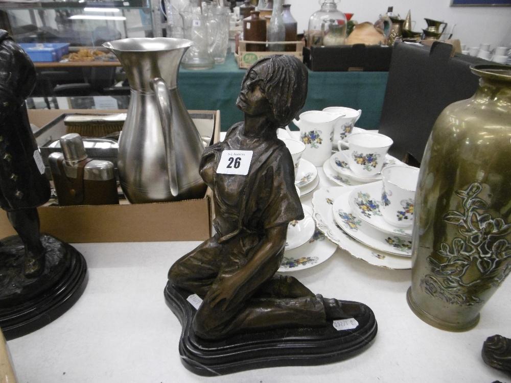 Lot 64 - A bronze sculpture of a kneeling lady