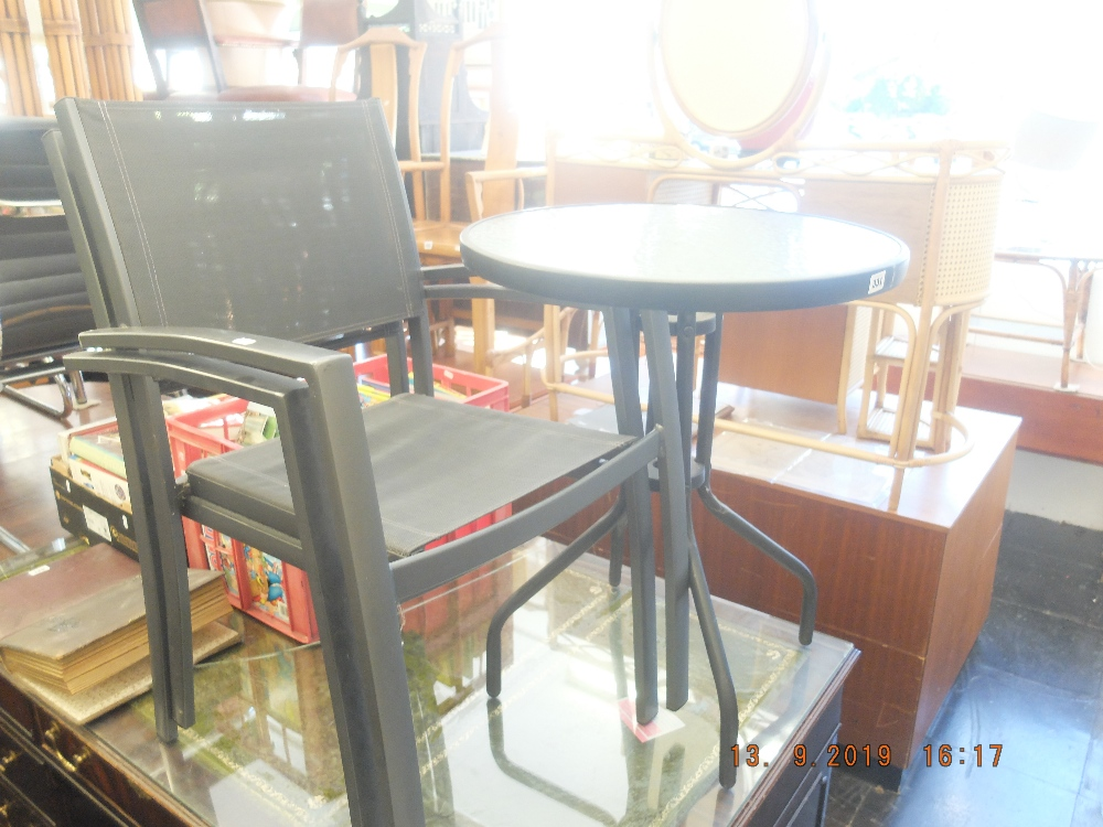 Lot 331 - A garden table and two chairs