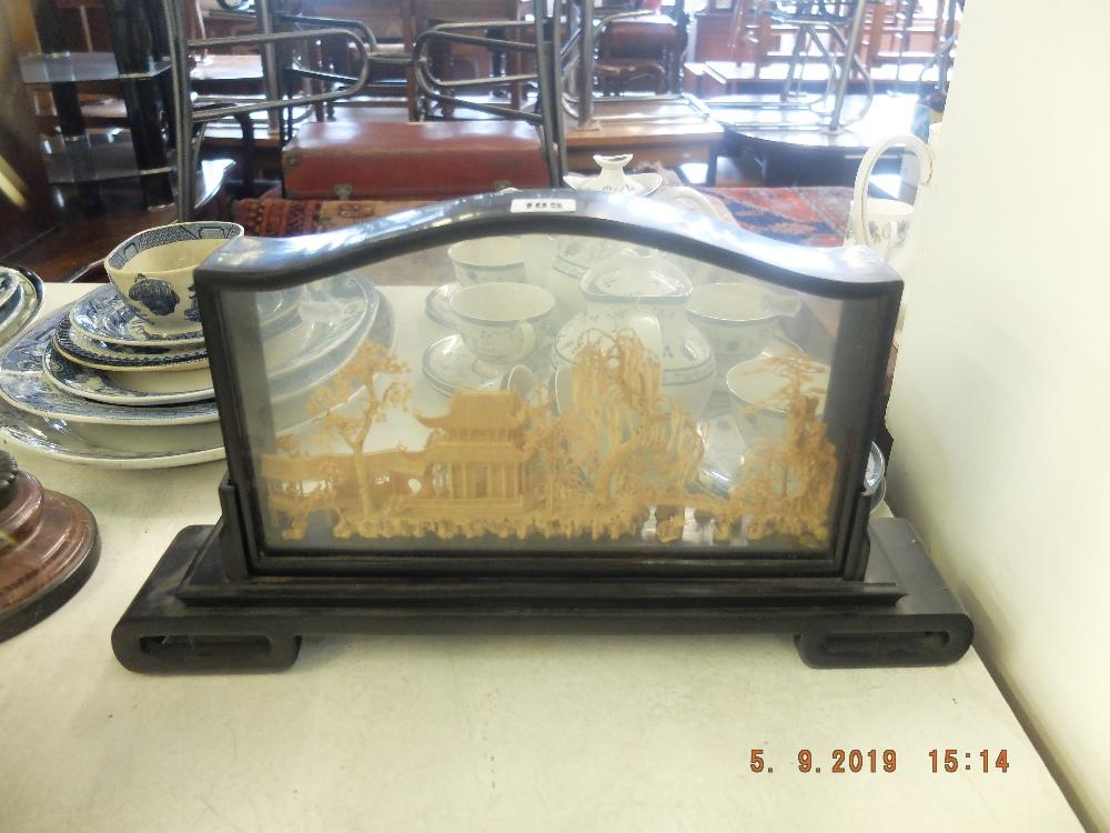Lot 51 - An oriental cork sculpture in a hardwood frame