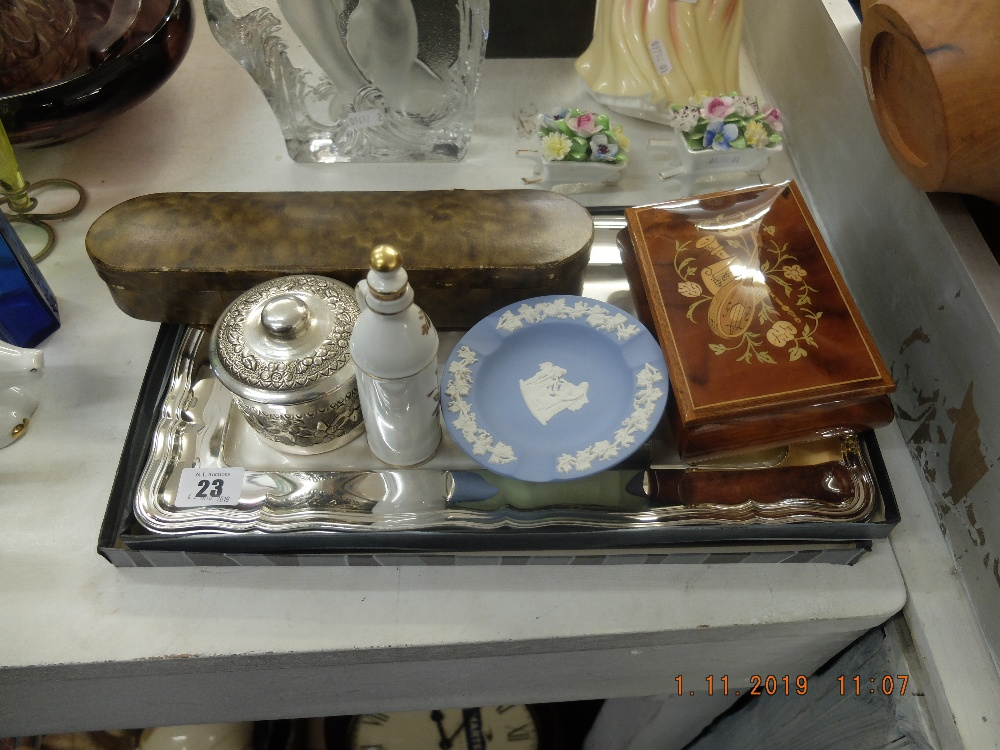 Lot 23 - A quantity of assorted sundries including a silver double stamp holder and a WMF tray