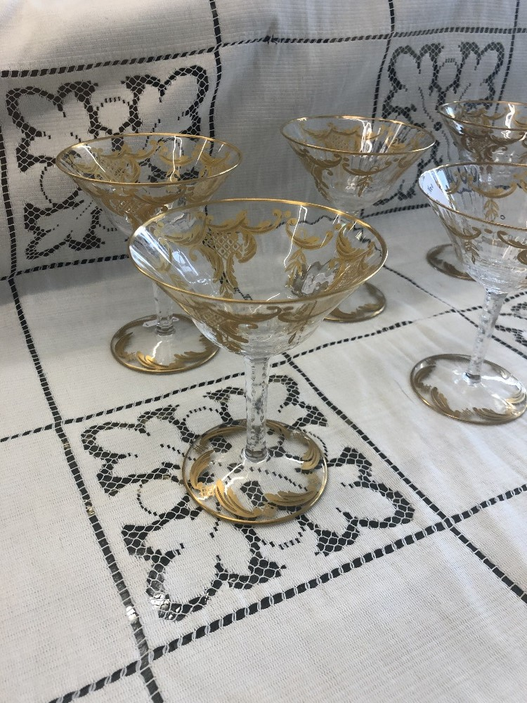 Lot 51 - A fine quality set of six cut crystal and gilt overlay thistle champagne coupes, glasses unmarked,