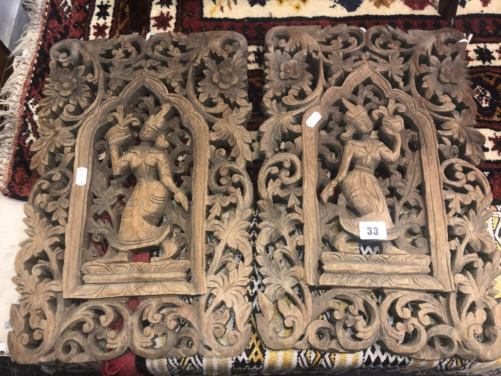 Lot 33 - A pair of carved wood plaques