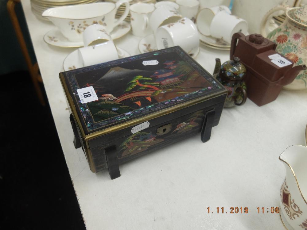 Lot 14 - An oriental jewellery box