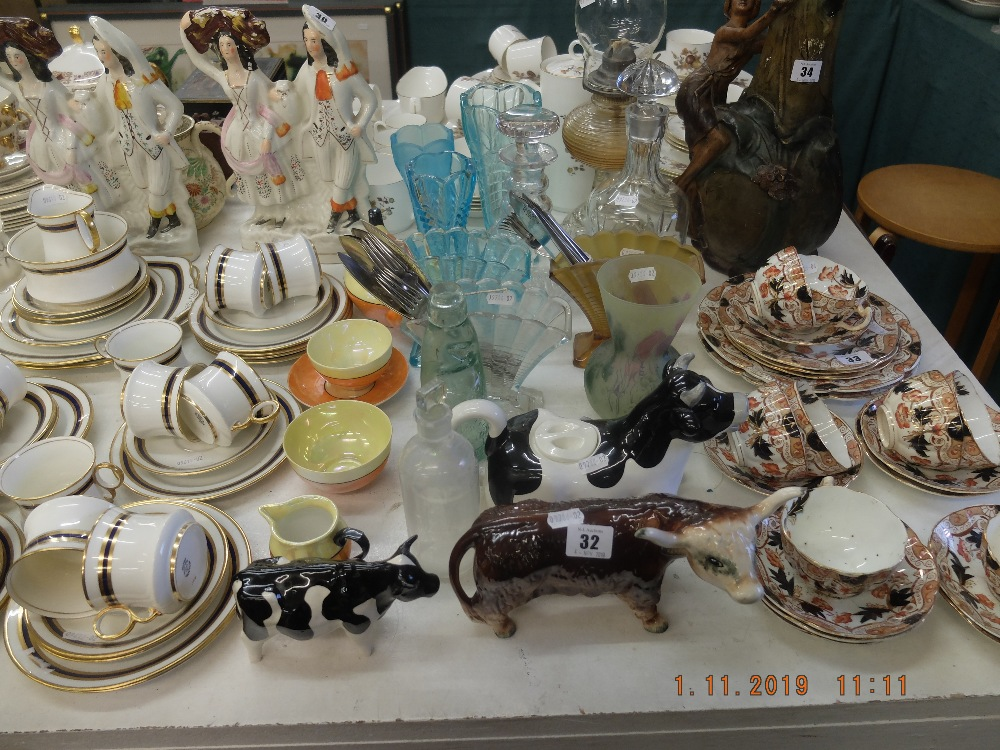 Lot 30 - A mixed assortment of assorted sundries including oil lamp and bachelor tea set