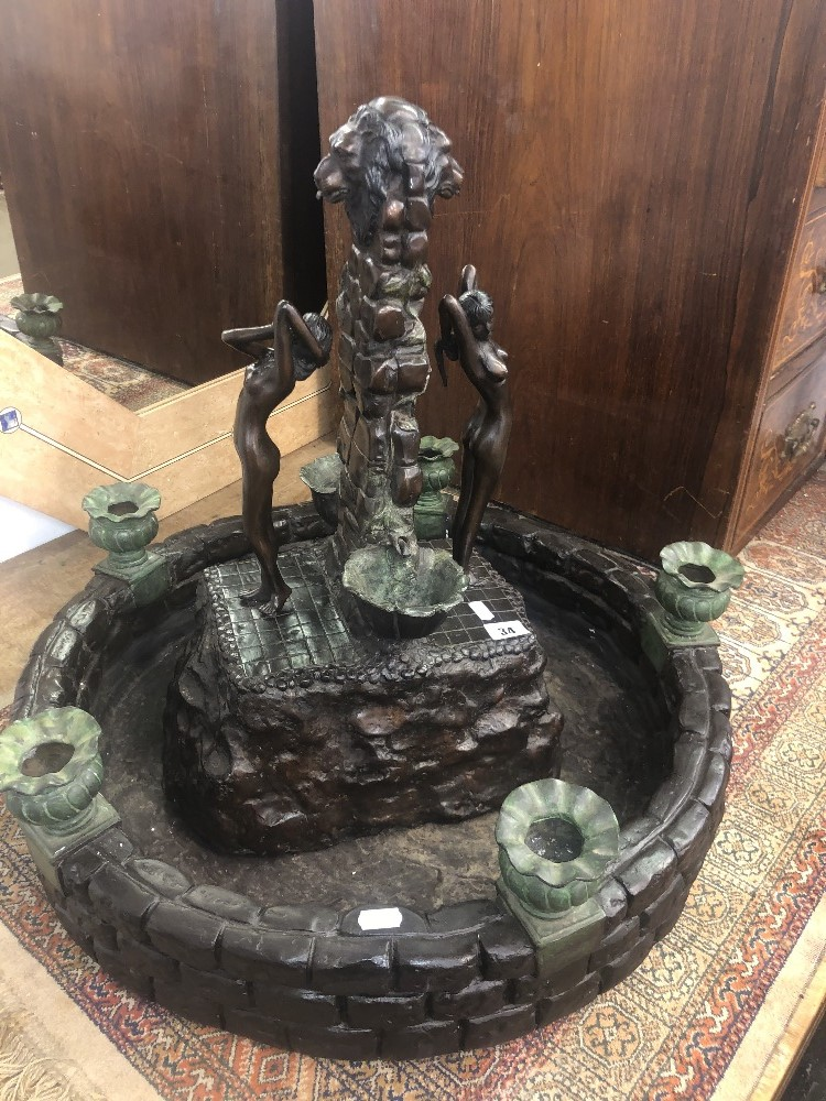 Lot 34 - A bronze indoor fountain
