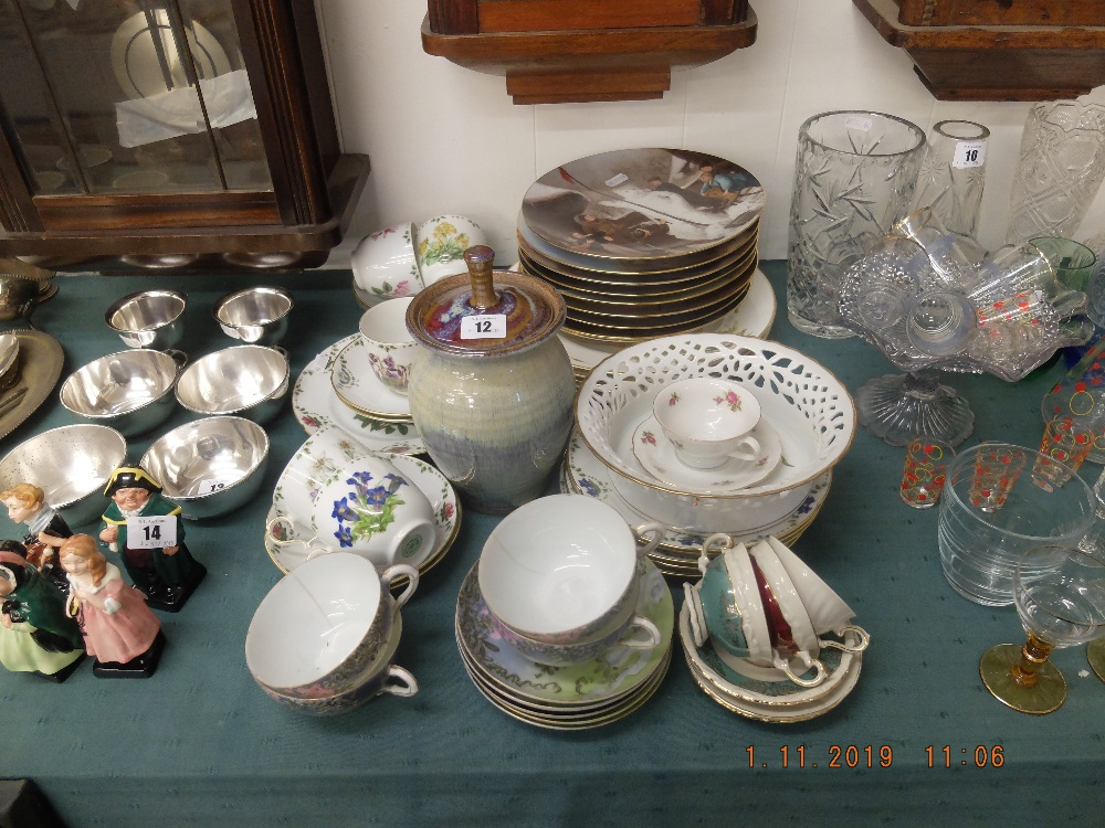 Lot 12 - A quantity of assorted trios and other items of chinaware