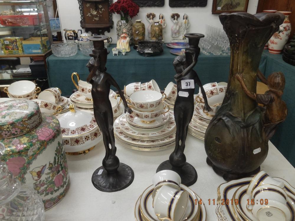 Lot 37 - A pair of art nouveau candlesticks