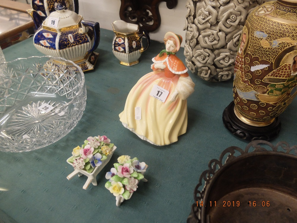 Lot 17 - A Royal Doulton figurine and two Doulton posies