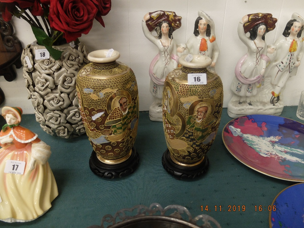 Lot 16 - A pair of Satsuma vases on stands