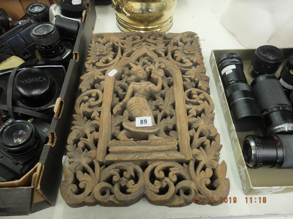 Lot 89 - A pair of carved wood plaques