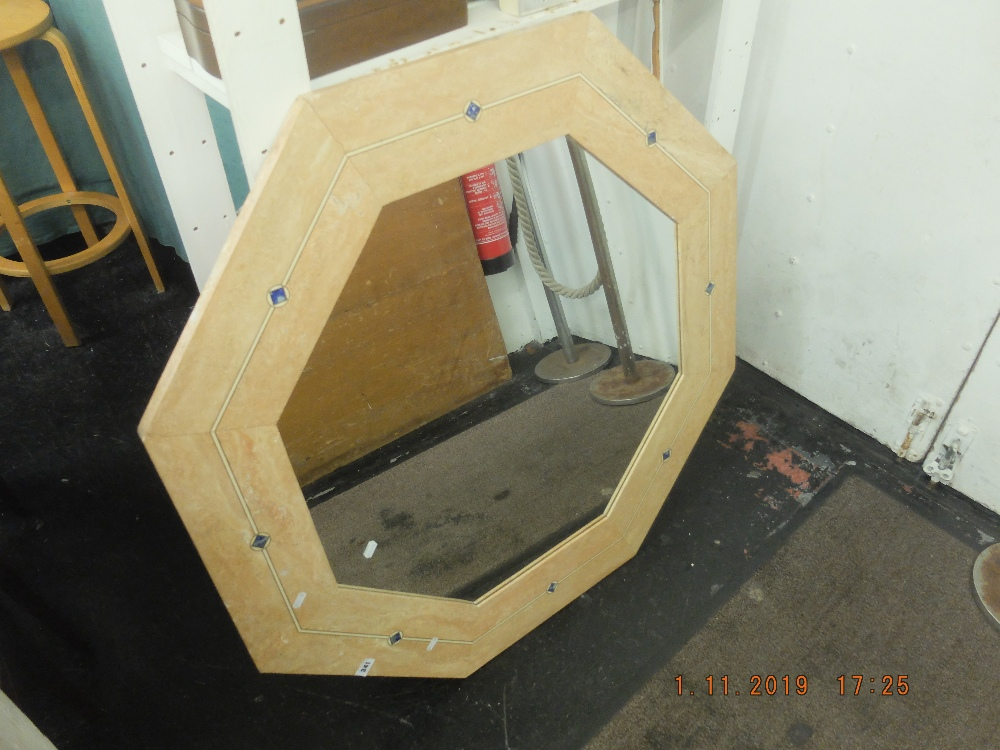 Lot 266 - An octagonal stone mirror
