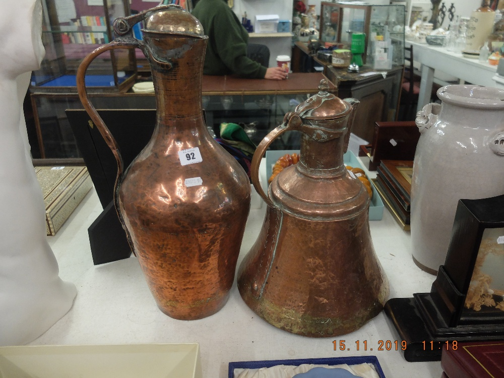 Lot 92 - A pair of brass and copper jugs