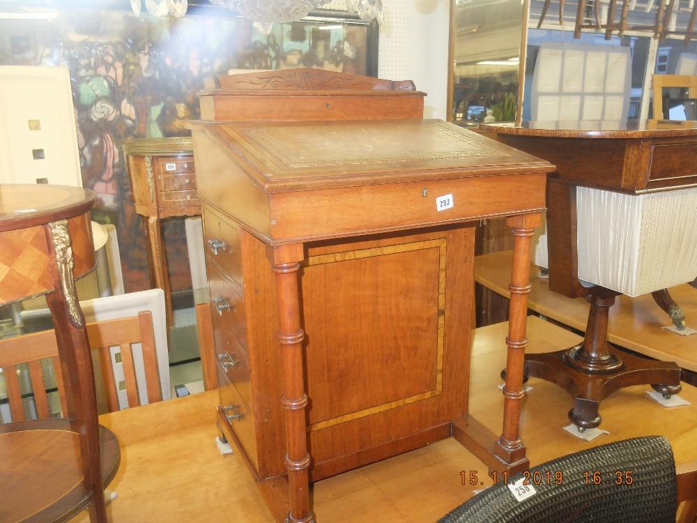 Lot 252 - A mid Victorian mahogany davenport