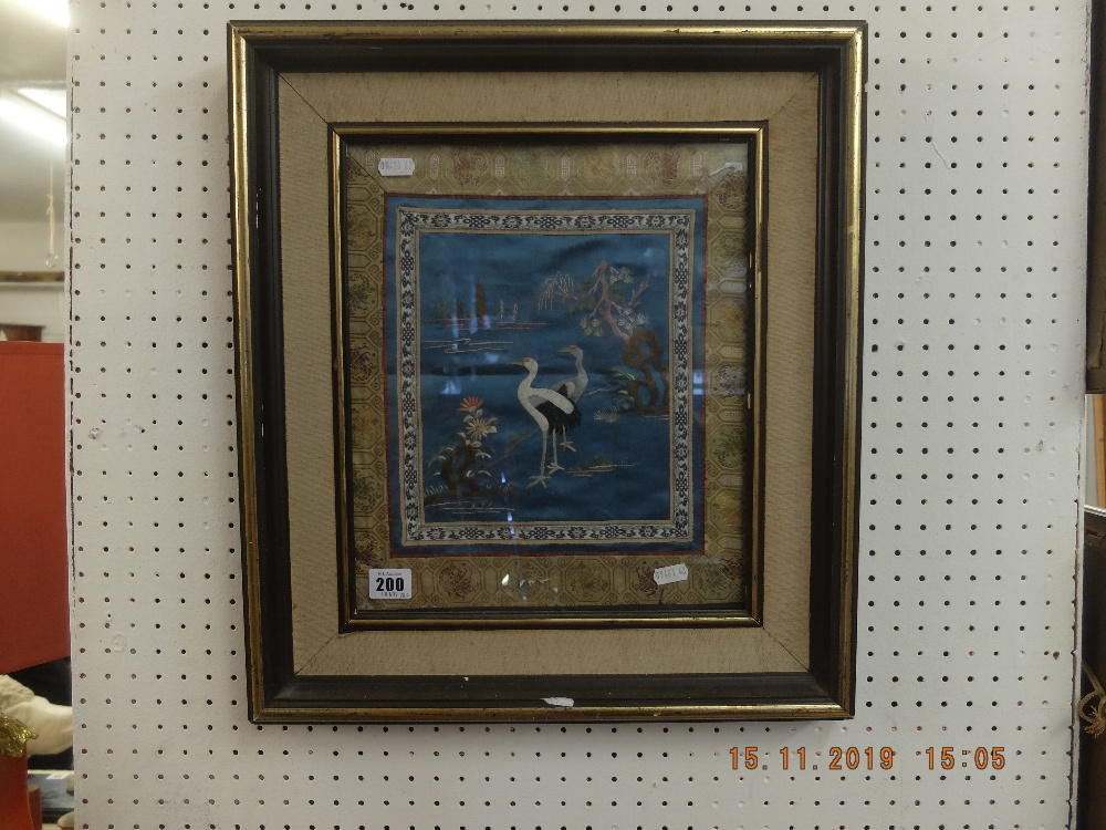 Lot 200 - A framed Japanese silk embroidery of herons circa 1900
