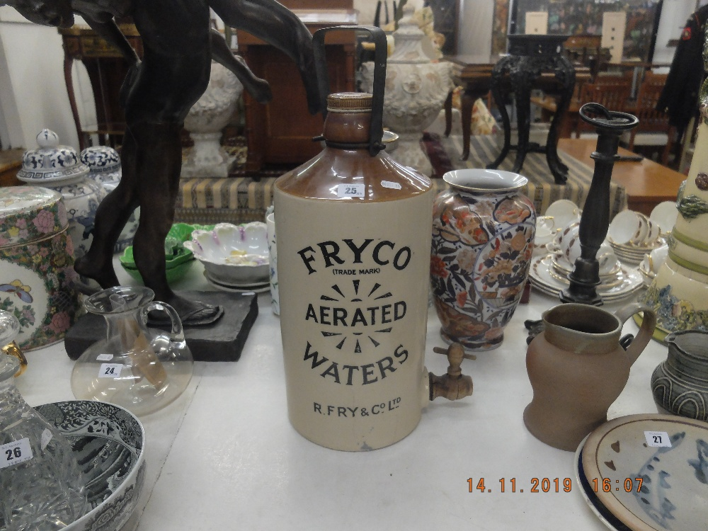 Lot 25 - An early water container with advertising