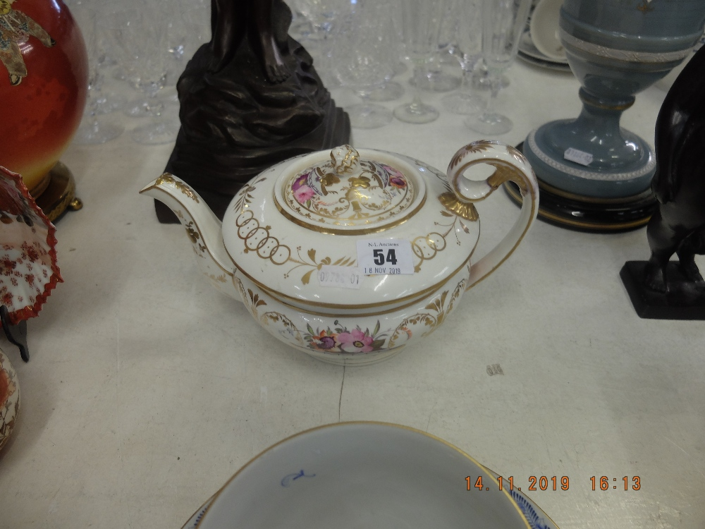 Lot 54 - A late 18th Century hand painted porcelain tea pot,