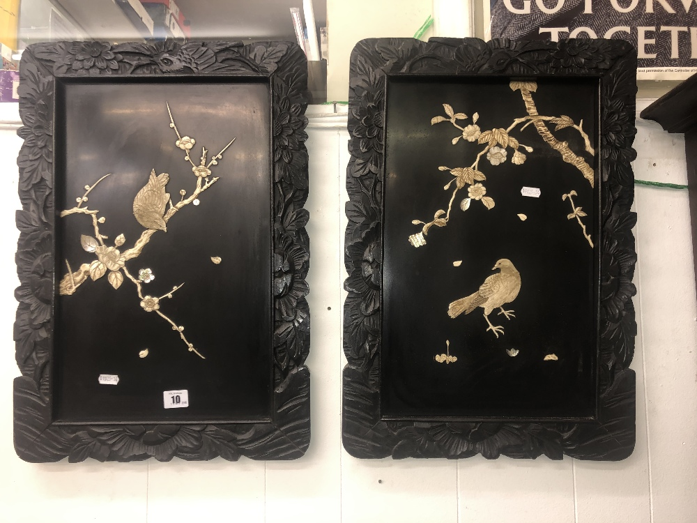 Lot 12 - A pair of black lacquered wall panels