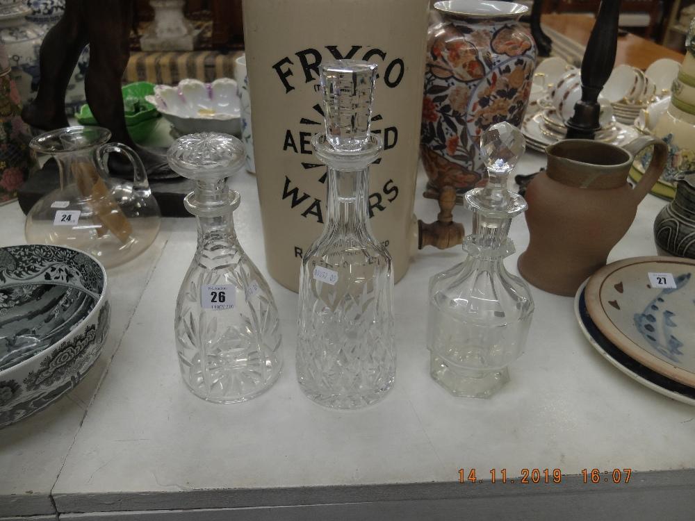Lot 26 - Three cut glass decanters