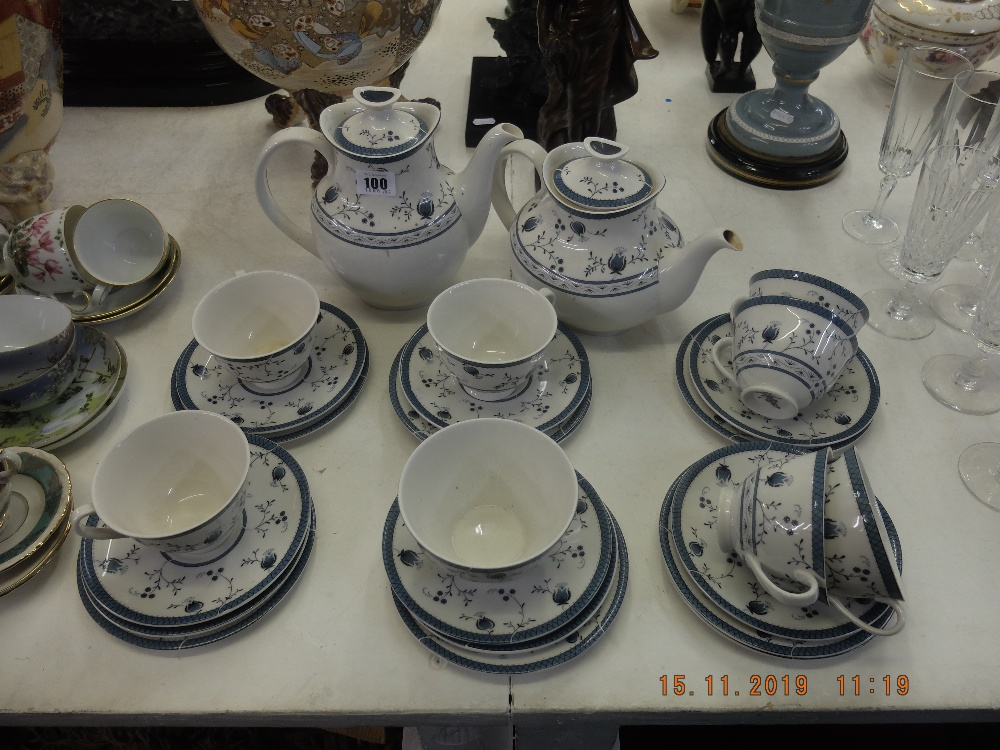 Lot 100 - A Royal Doulton Cambridge blue and white tea and coffee service