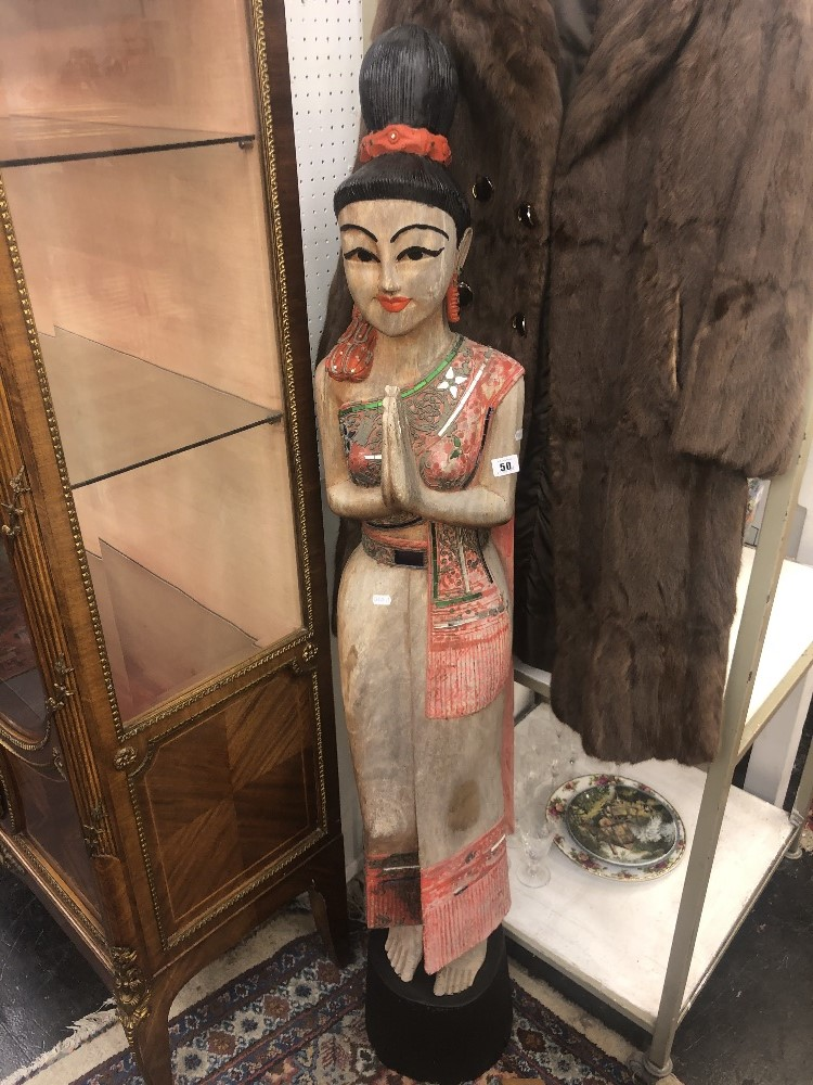 Lot 47 - A carved wood oriental lady