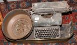 Lot 259 - An Oliver vintage typewriter, along with a brass fender and copper filter.
