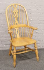 Lot 603 - A hardwood spindle back Windsor arm chair.