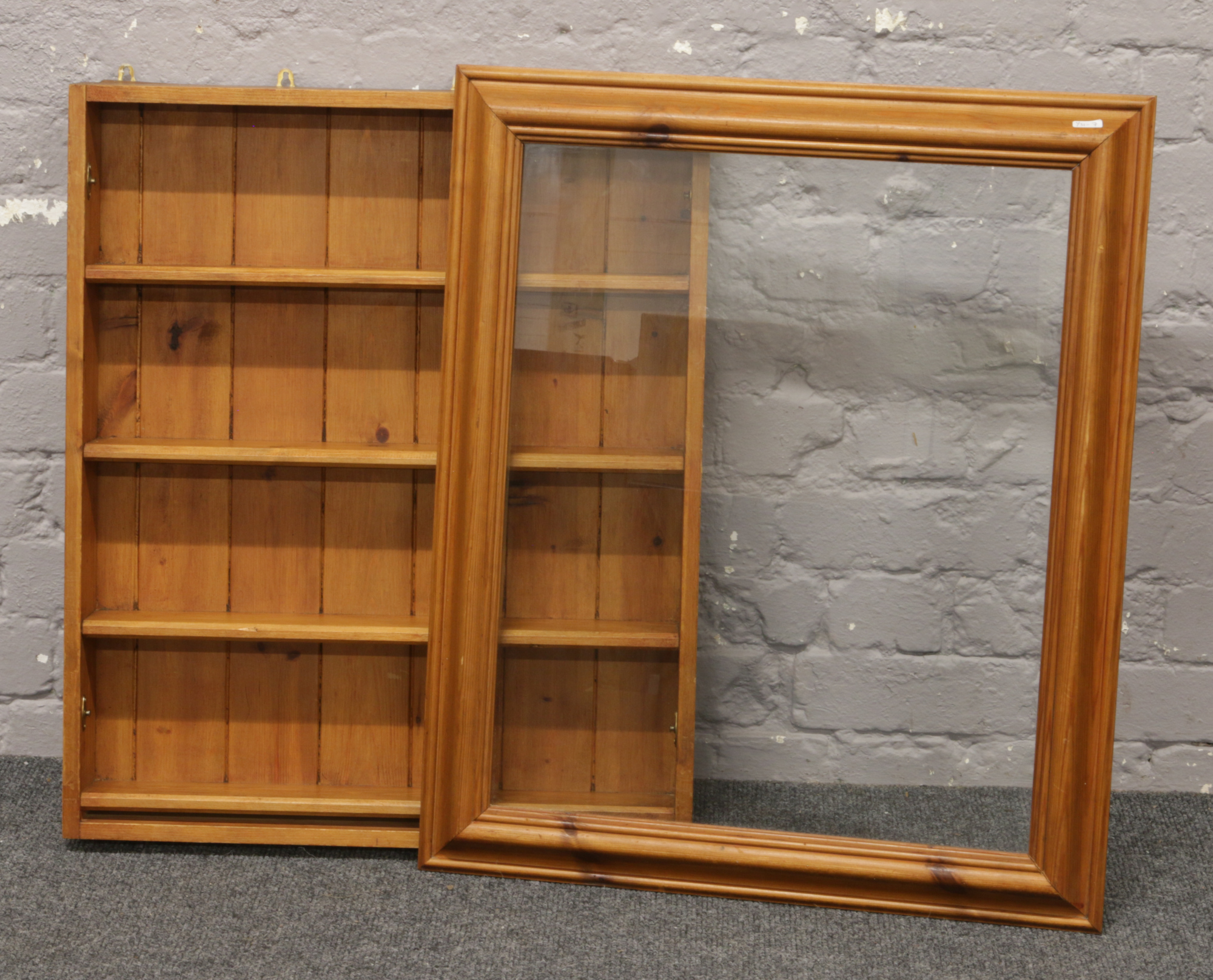 Lot 302 - A pine wall hanging display case.