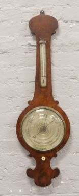 Lot 304 - A Regency mahogany banjo barometer with silvered dials, 102cm.Condition report intended as a guide