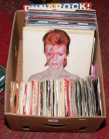 Lot 200 - A box of approximately 29 L.P records and over 100 singles to include Queen, David Bowie, Kiss, Thin