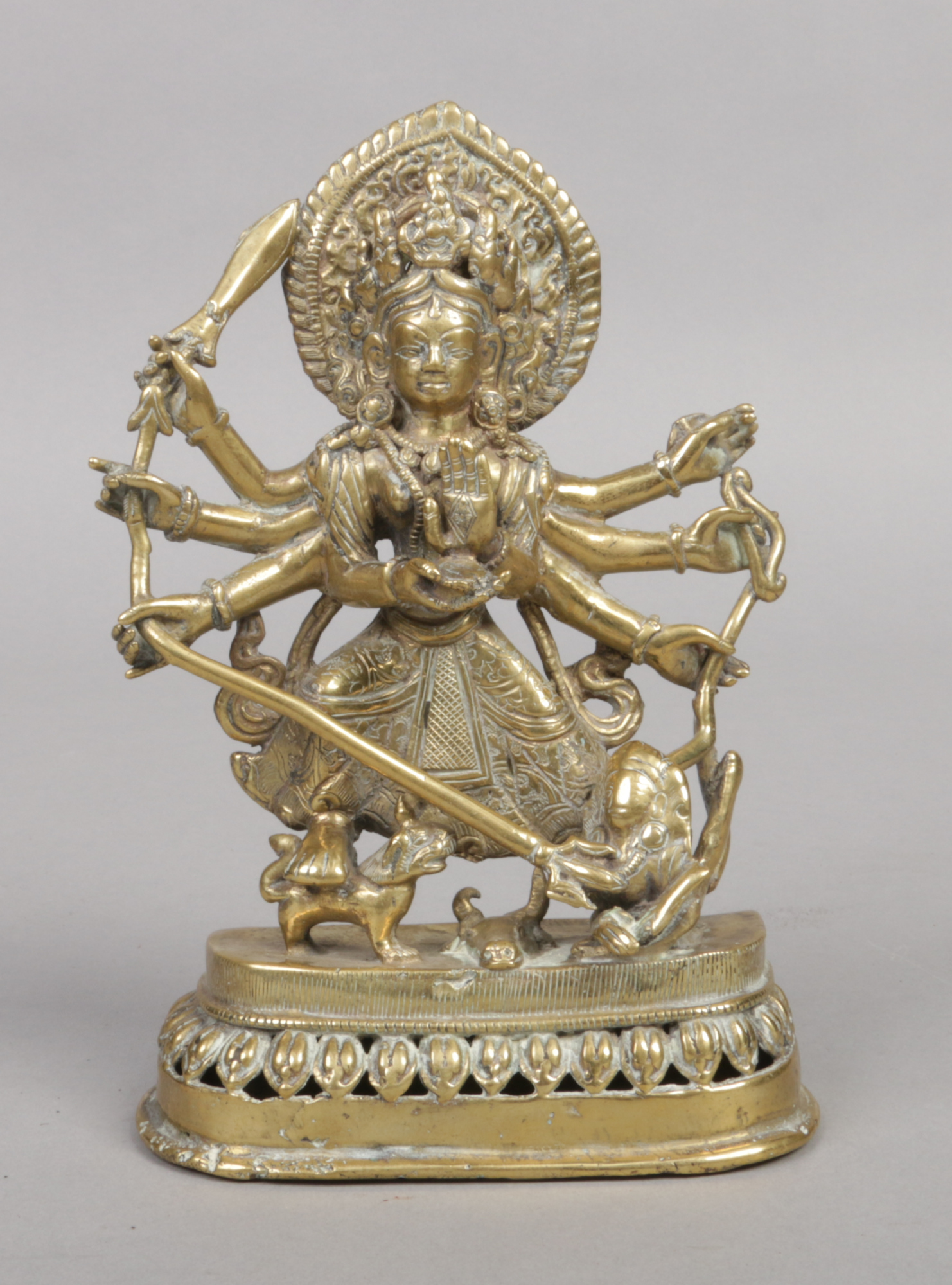 Lot 207 - A 17th century Sino-Tibetan polished bronze devotional statue. Formed as an eight armed Buddha