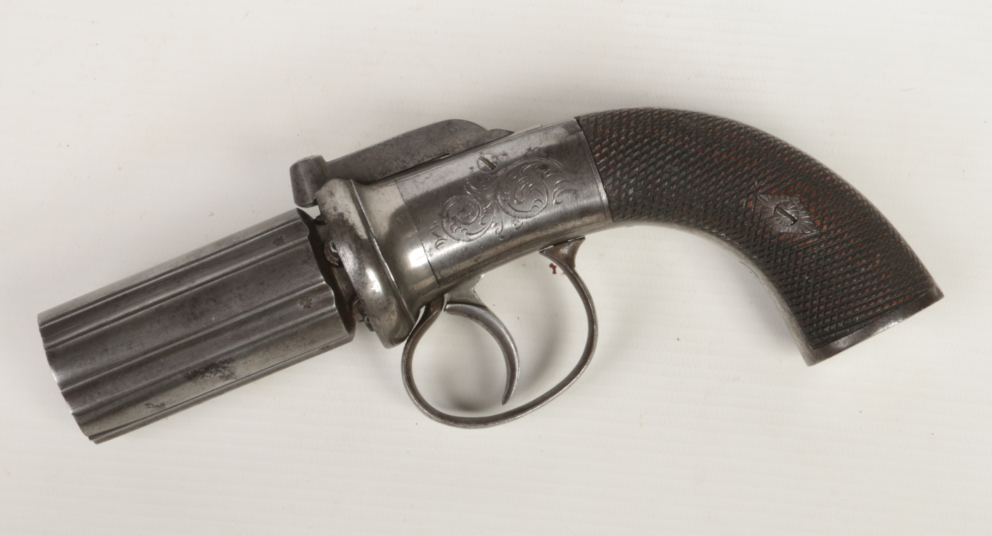 Lot 272 - A mid 19th century six-shot pepperbox revolver. With fluted barrels, engraved round action, tang and
