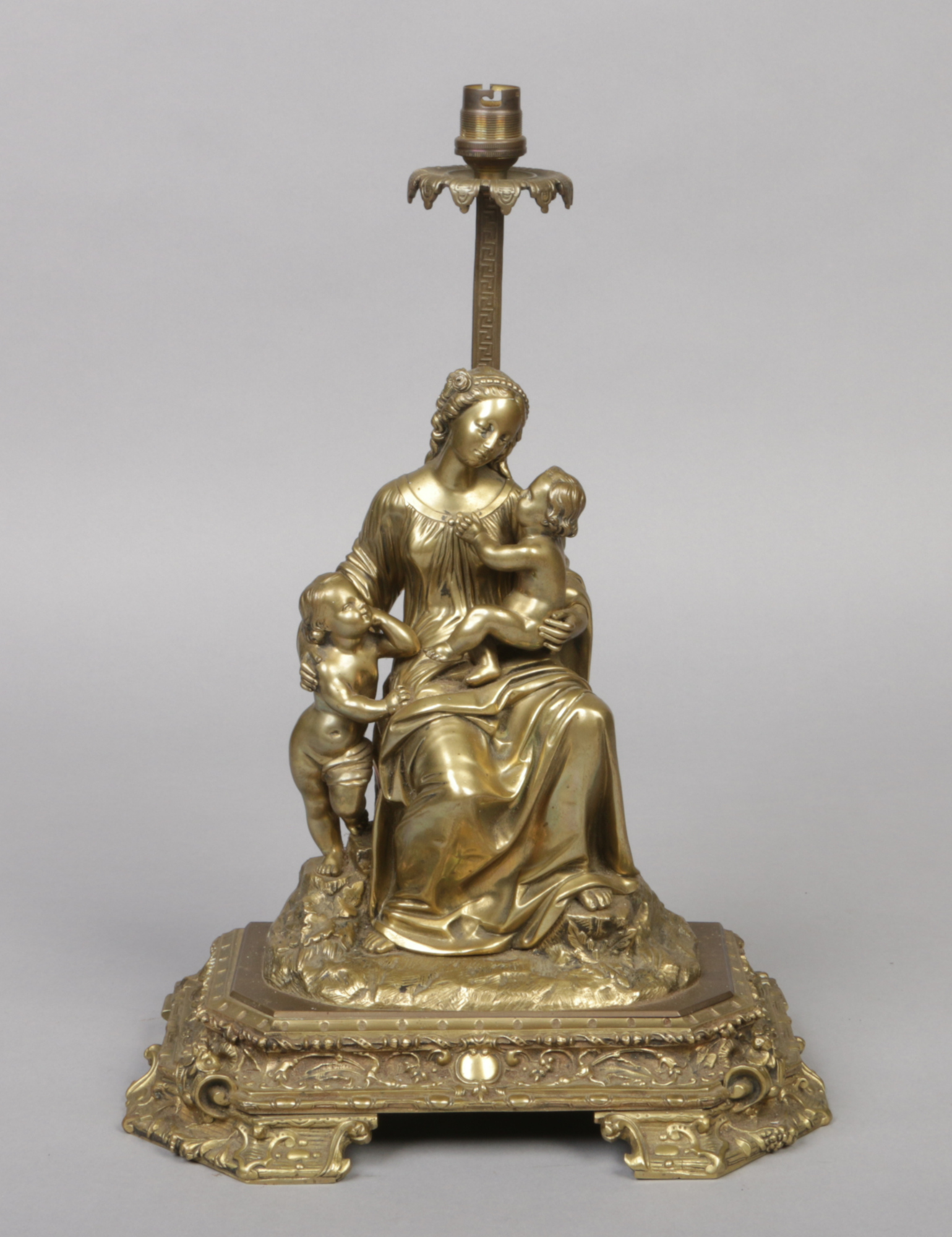 Lot 276 - A 19th century bronze figure later converted to a table lamp. Modelled as the Madonna and Child with