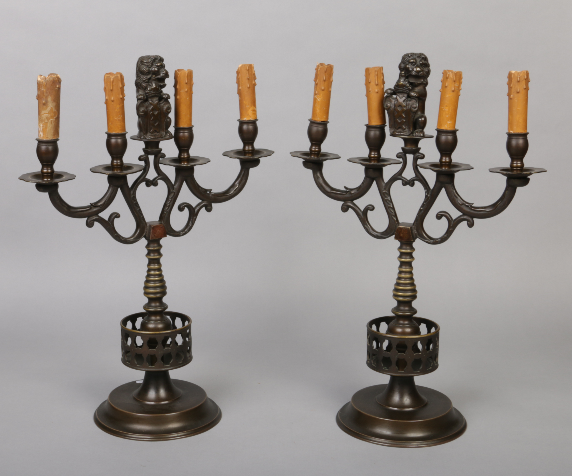 Lot 244 - A pair of Dutch 18th century style bronze armorial four branch candelabra / tablelamps. Each with