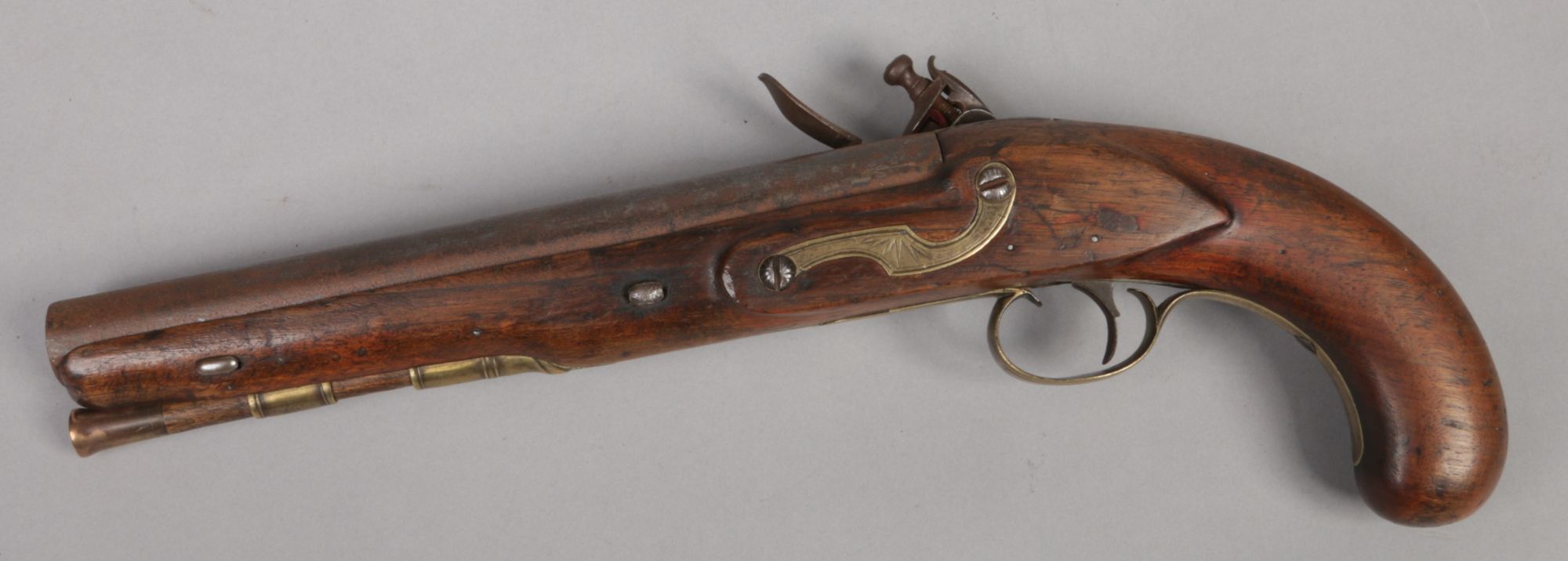 Lot 270 - An 18th century flintlock coaching pistol with safety by J. Harding .700. Inscribed, with walnut
