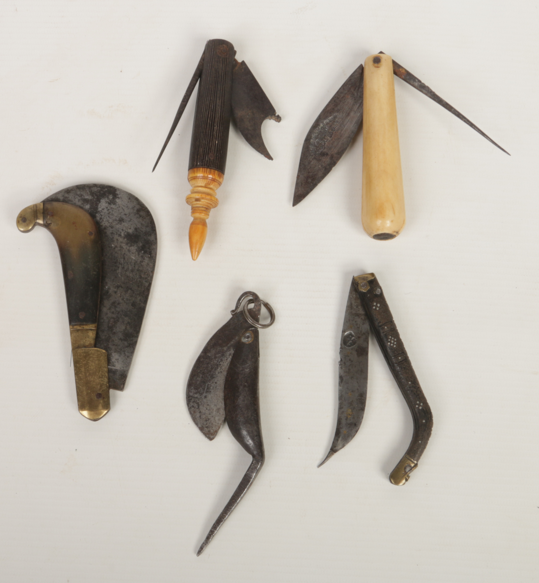 Lot 266 - Five Eastern folding knives, mainly 18th century. One double bladed example with reeded carvings and
