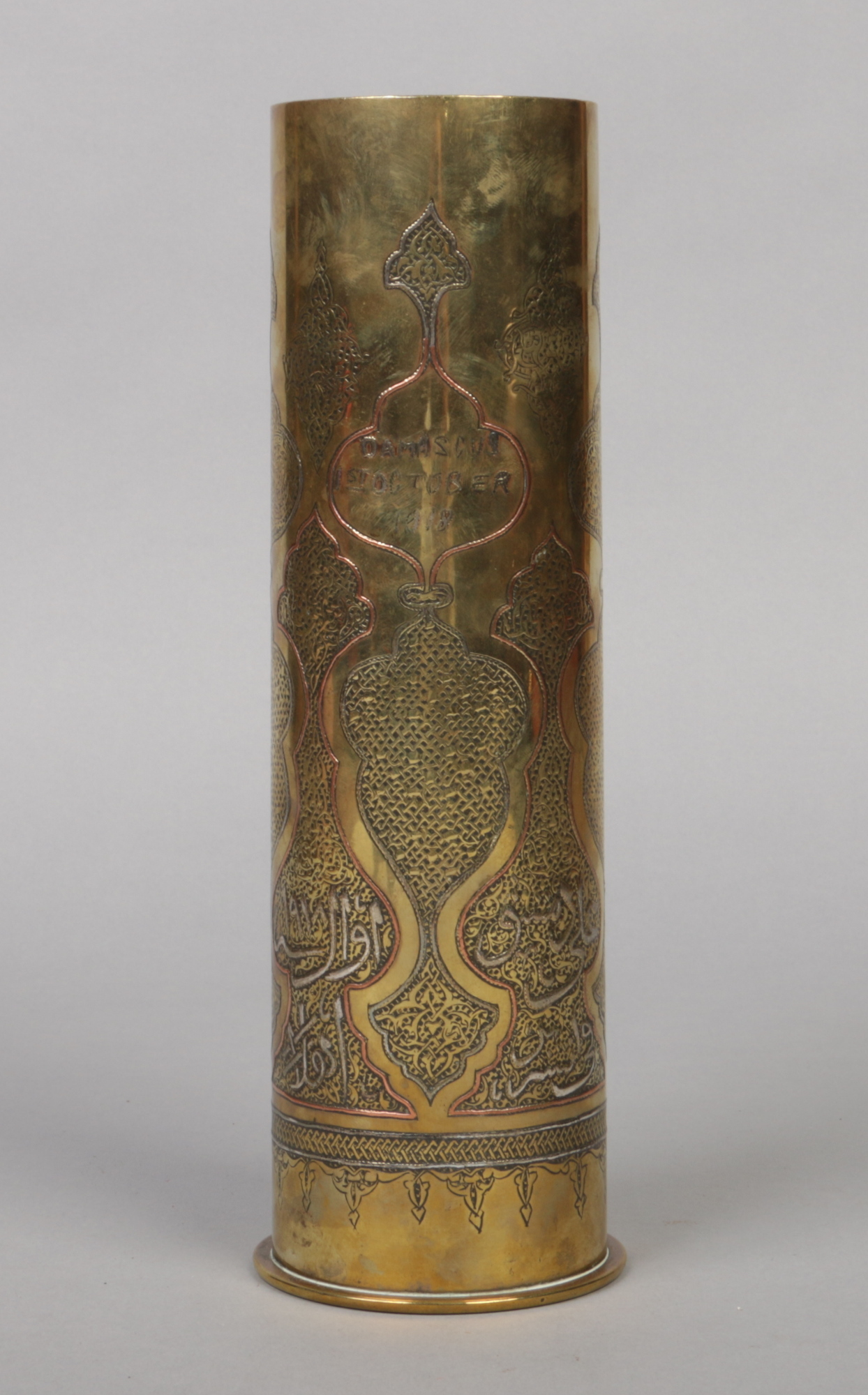 Lot 355 - A German First World War Trench Art brass shell casing. With Islamic engraved, silver and copper