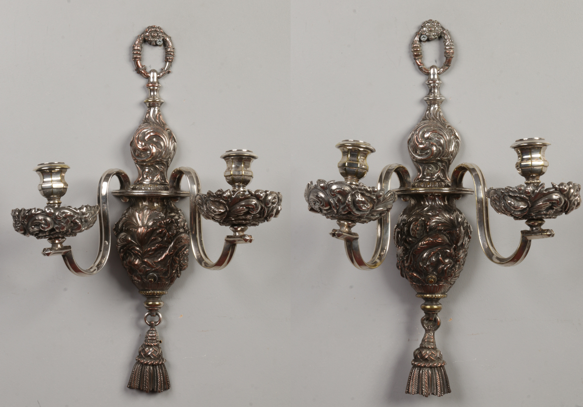 Lot 246 - A pair of silver plated twin branch wall lights. Cast in relief with scrolling foliage and flowers