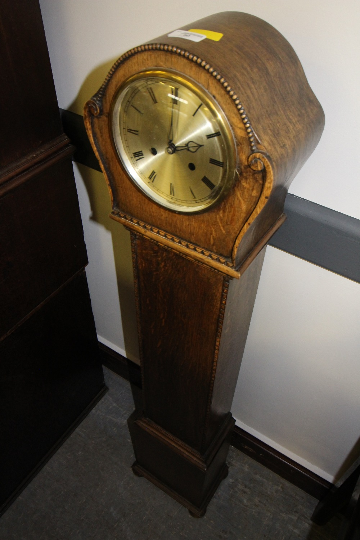 Lot 60 - Oak Grandmother Clock