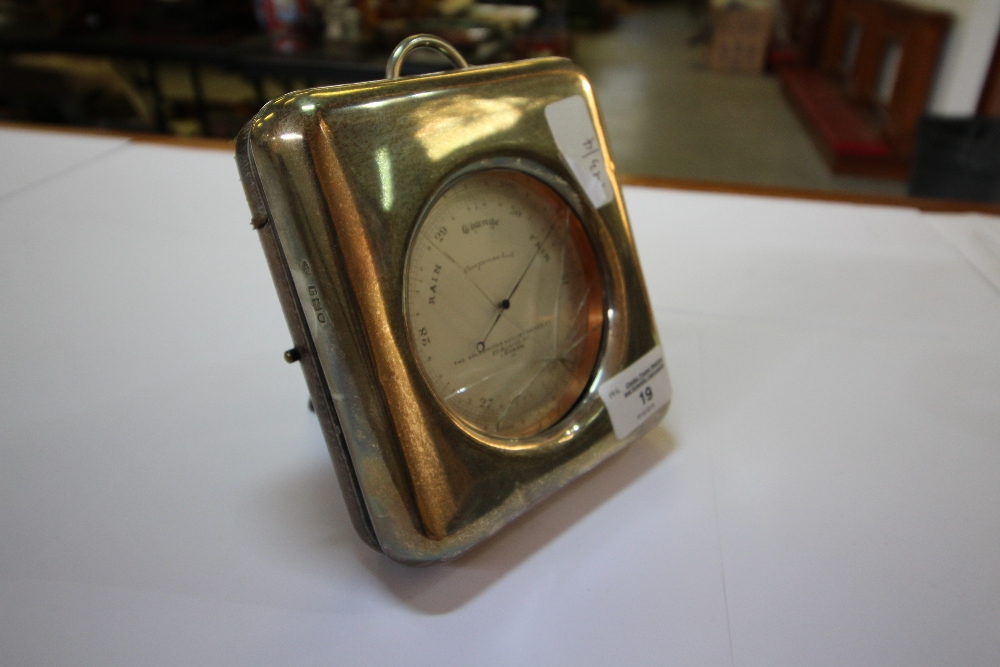 Lot 19 - Goldsmiths and Silversmiths barometer in silver mounted case (af)
