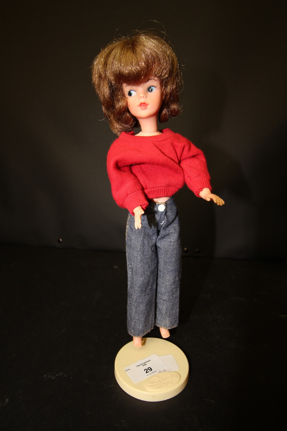 Lot 29 - Sindy doll and stand